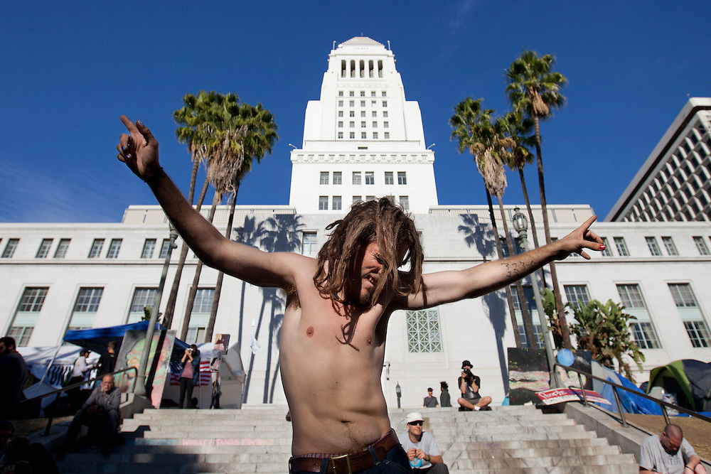 Sam Gaddis dances to frenetic beats in front of city hall during Occupy LA on Sunday, November 13, 2011 in Los Angeles, Calif. (Photo by Gabriel Romero ©2011)