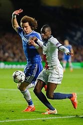 PSG Midfielder Blaise Matuidi (FRA) is challenged by Chelsea Defender David Luiz (BRA) - Photo mandatory by-line: Rogan Thomson/JMP - 07966 386802 - 08/04/2014 - SPORT - FOOTBALL - Stamford Bridge, London - Chelsea v Paris Saint-Germain - UEFA Champions League Quarter-Final Second Leg.
