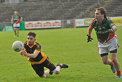 Lahardane's Phillip O'Malley get's his pass away during the junior final.<br /> Pic Conor McKeown