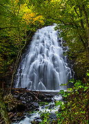 The Autumn colors begin to appear at Crabtree Falls in North Carolina.<br /> <br /> &copy; Photography by Kathy Kmonicek