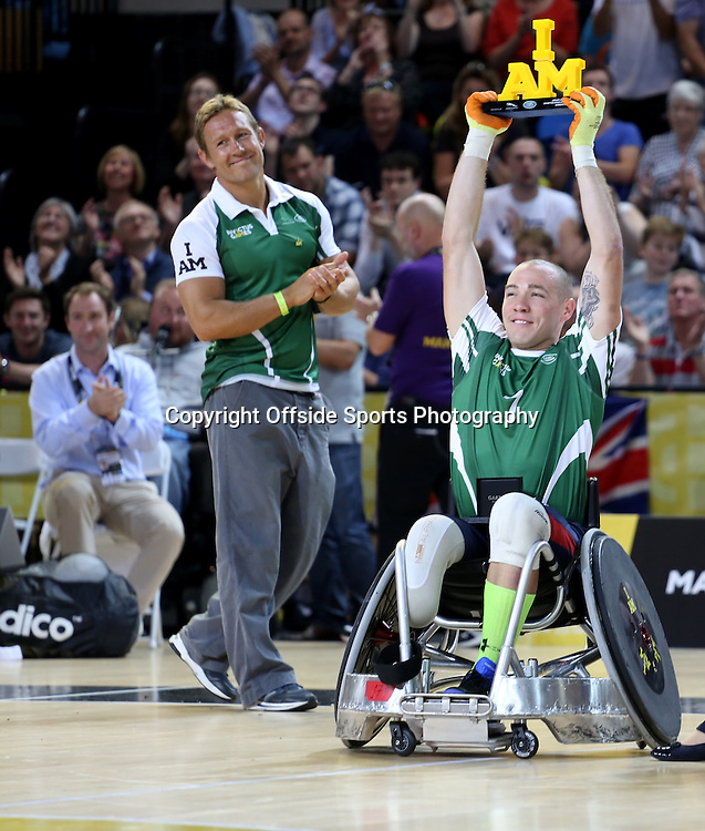 12 September 2014 - Invictus Games Day 2 - Wheelchair Rugby Celebrity Match - Ryan McIntosh lifts the I AM trophy for team Invictus.<br /> Photo: Ryan Smyth/Offside