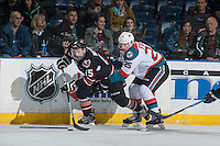 KELOWNA, CANADA - FEBRUARY 1: Cal Foote #25 of the Kelowna Rockets back check Tristen Nielsen #15 of the Calgary Hitmen on February 1, 2017 at Prospera Place in Kelowna, British Columbia, Canada.  (Photo by Marissa Baecker/Shoot the Breeze)  *** Local Caption ***