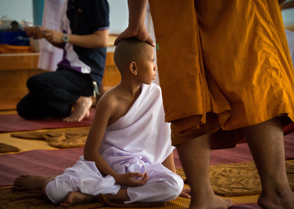 Young men become novice monks in rural Nakhon Nayok, Thailand.