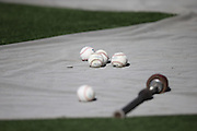 LOS ANGELES, CA - JUNE 17:  Baseballs and a bat lie on a tarp during batting practice before the Los Angeles Dodgers game against the Colorado Rockies at Dodger Stadium on Tuesday, June 17, 2014 in Los Angeles, California. The Dodgers won the game 4-2. (Photo by Paul Spinelli/MLB Photos via Getty Images)