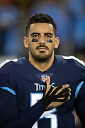 Tennessee Titans quarterback Marcus Mariota (8) holds his hand over his heart during the playing of the National Anthem before the week 14 regular season NFL football game against the Jacksonville Jaguars on Thursday, Dec. 6, 2018 in Nashville, Tenn. The Titans won the game 30-9. (©Paul Anthony Spinelli)