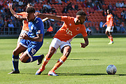 Blackpool Defender, Curtis Tilt (16) ands Oldham Athletic Forward, Aaron Holloway (10) during the EFL Sky Bet League 1 match between Blackpool and Oldham Athletic at Bloomfield Road, Blackpool, England on 26 August 2017. Photo by Mark Pollitt.