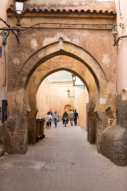 MARRAKESH, MOROCCO - 19TH APRIL 2016 - Tourists exploring the Marrakesh Medina, Morocco.