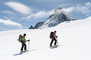 Dent d'Herens and two alpinists on the Stockjigletscher, Valais, Switzerland