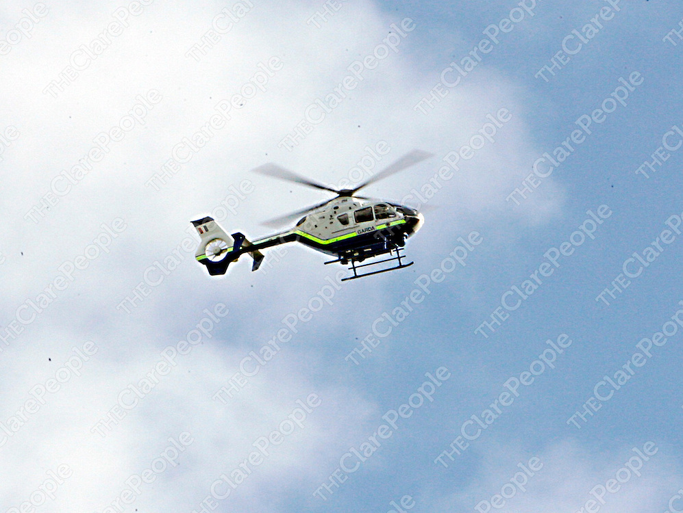 A Garda helecopter circles over Crowe Street after a man barricaded himself into his house in Gort on Sunday night.<br />