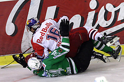 Ziga Pavlin of Olimpija under Patrick Harand of Salzburg at sixth game of the Final of EBEL league (Erste Bank Eishockey Liga) between ZM Olimpija vs EC Red Bull Salzburg,  on March 25, 2008 in Arena Tivoli, Ljubljana, Slovenia. Red Bull Salzburg won the game 3:2 and series 4:2 and became the Champions of EBEL league 2007/2008.  (Photo by Vid Ponikvar / Sportal Images)..