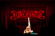 A burlesque artist performs her routine at the London Burlesque Festival, May 11, 2013, in London, England. (Photo by Warrick Page)