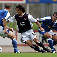 St Johnstone v Raith Rovers...28.08.04<br />Francisco Ortiz is tracked by David Hannah and Paul Sheerin<br /><br />Picture by Graeme Hart.<br />Copyright Perthshire Picture Agency<br />Tel: 01738 623350  Mobile: 07990 594431