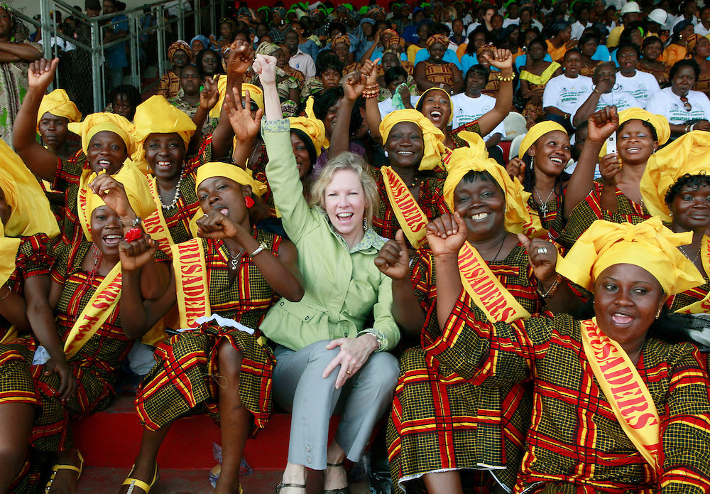 Kathy Calvin, CEO U.N. Foundation is joined by female performers at the Antoinette Tubman Stadium during the International Women's Day celebration in Monrovia, Liberia, Tuesday, March 8, 2011. The celebration commemorates the 100th anniversary of International Women's Day. (Stuart Ramson/Insider Images for the United Nations Foundation)