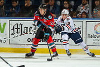 KELOWNA, BC - OCTOBER 12: Orrin Centazzo #19 of the Kamloops Blazers back checks Kyle Topping #24 of the Kelowna Rockets as he skates with the puck and looks for the pass at Prospera Place on October 12, 2019 in Kelowna, Canada. (Photo by Marissa Baecker/Shoot the Breeze)