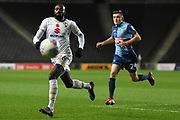Milton Keynes Dons midfielder Hiram Boateng (26) sprints forward with the ball  during the EFL Trophy match between Milton Keynes Dons and Wycombe Wanderers at stadium:mk, Milton Keynes, England on 12 November 2019.