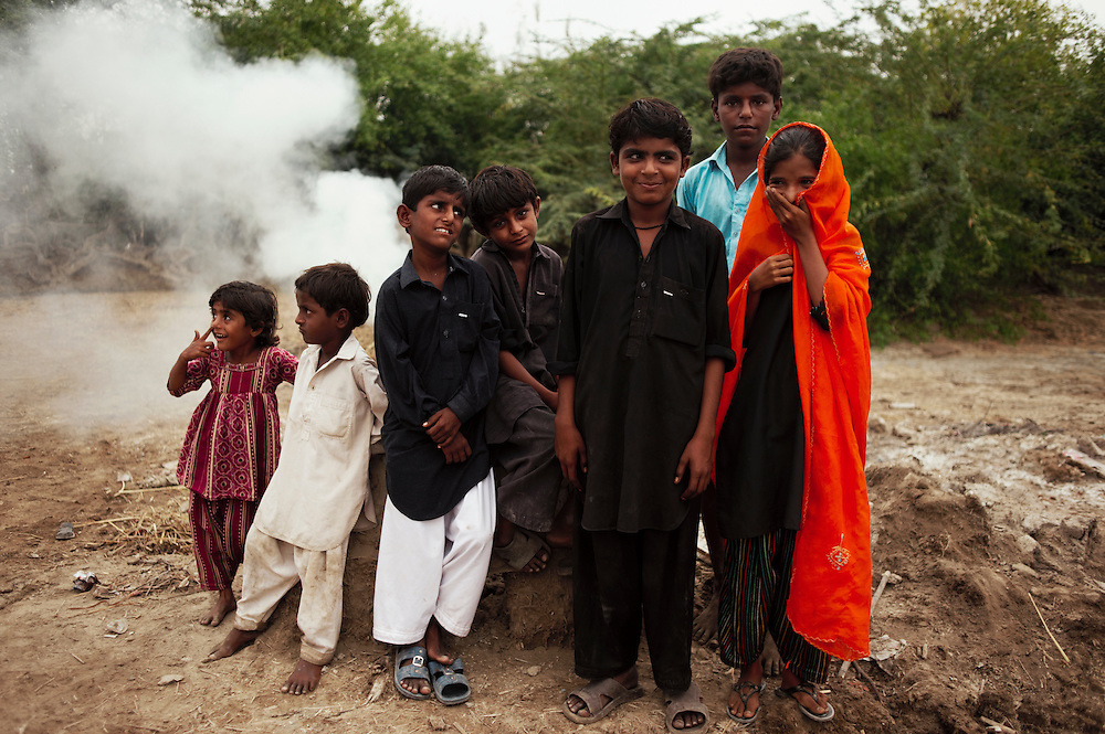 Anila, 5, Sherzama, 5, Nadeem, 7 M. Moosa, 7, Shahbaz, 9, Zahid Hussain, 13 and Sannam, 10 stand outside their home within the village of Juman Namllah, a displaced flood community in Badin District, Sindh, Pakistan on November 2,  2011 In August 2011, Heavy monsoon rains triggered flooding in lower parts of Sindh and northern parts of Punjab.