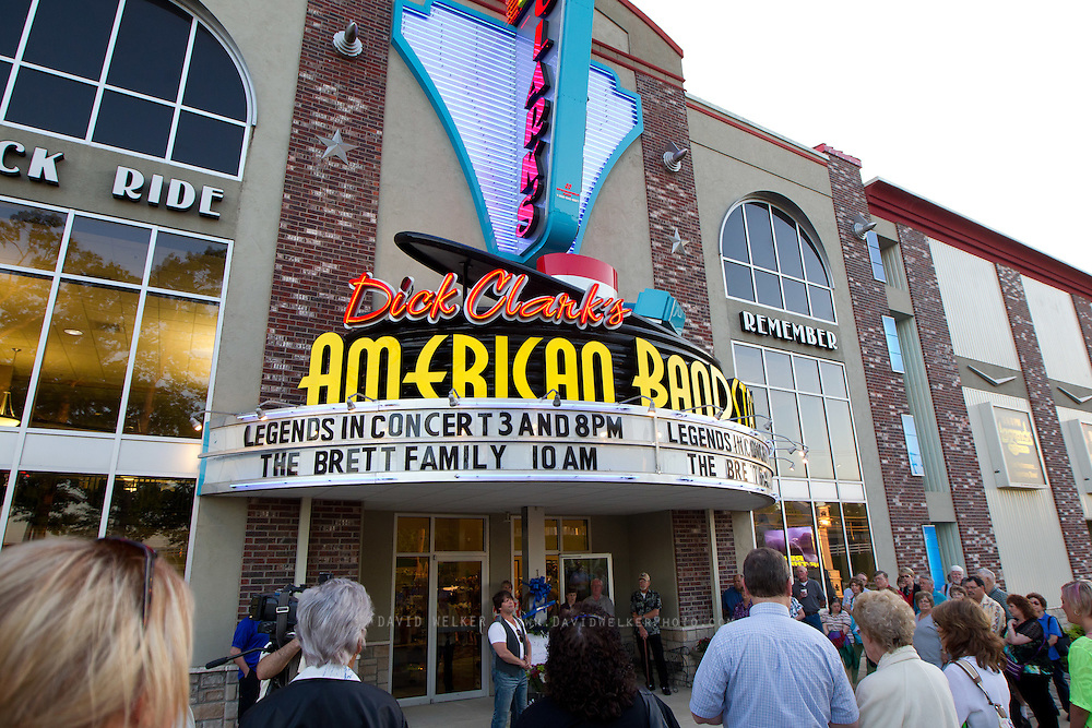 BRANSON, MO - APRIL 18: A crowd stands by the entrance of Dick Clark's American Bandstand during a candlelight vigil in honor of Dick Clark on April 18, 2012 in Branson, Missouri.  (Photo by David Welker/Getty Images)*** Local Caption ***