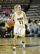 28 NOVEMBER 2007: Iowa guard Kristi Smith (11) in the first half of Georgia Tech's 76-57 win over Iowa in the Big Ten/ACC Challenge at Carver-Hawkeye Arena in Iowa City, Iowa on November 28, 2007.