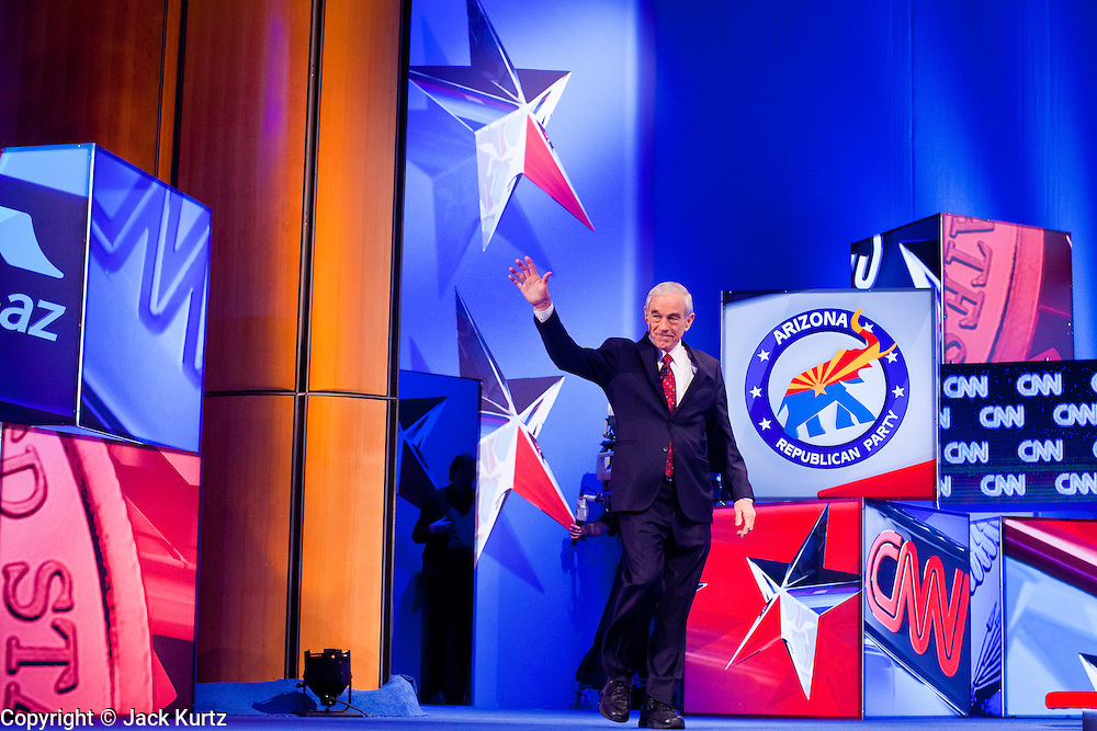"""22 FEBRUARY 2012 - MESA, AZ:  Congressman RON PAUL (left) walks on stage at the Arizona Republican Presidential Debate in the Mesa Arts Center in Mesa, AZ, Wednesday. It is the last debate before the Michigan and Arizona Republican primaries on Feb. 28 and """"Super Tuesday"""" on March 6. PHOTO BY JACK KURTZ"""