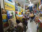 Old Town. Mass production of souvenir paintings with motifs from South East Asia, such as Angkor Temple reliefs.