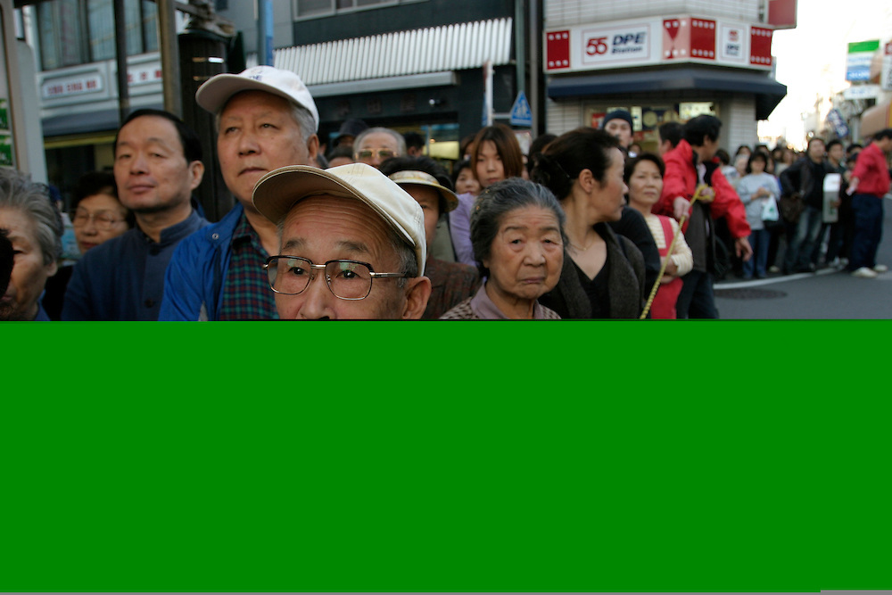 Locals at a rally for the re-election of Nobuteru ISHIHARA,  Minister of Land, Infrastructure and Transport in Japanese Prime Minister Koizmui's  New reform Cabinet .