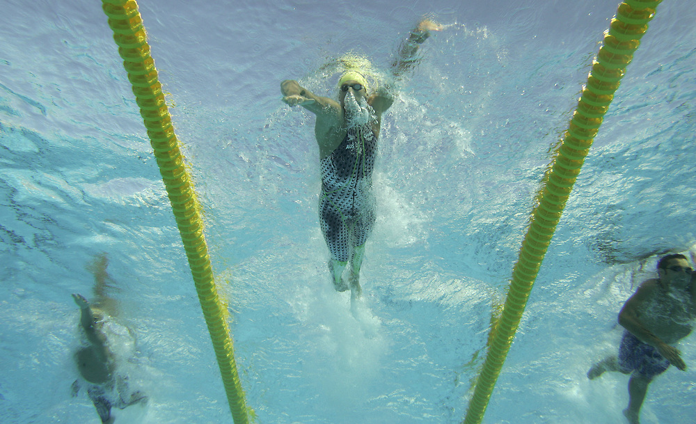 Australia's Grant Hackett pulls away from Japan's Takeshi Matsuda (L) and Romania's Dragos Coman (R) an route to his gold medal in the men's 400m Freestyle final at the FINA World Championships in Montreal, Canada Sunday 24 July, 2005.