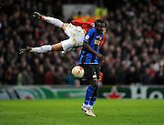 Sulley Muntari of Inter  and Cristiano Ronaldo of Manchester United compete for the ball during the UEFA Champions League First Knockout Round Second Leg match between Manchester United and Inter Milan at Old Trafford on March 11 2009, in Manchester, England.