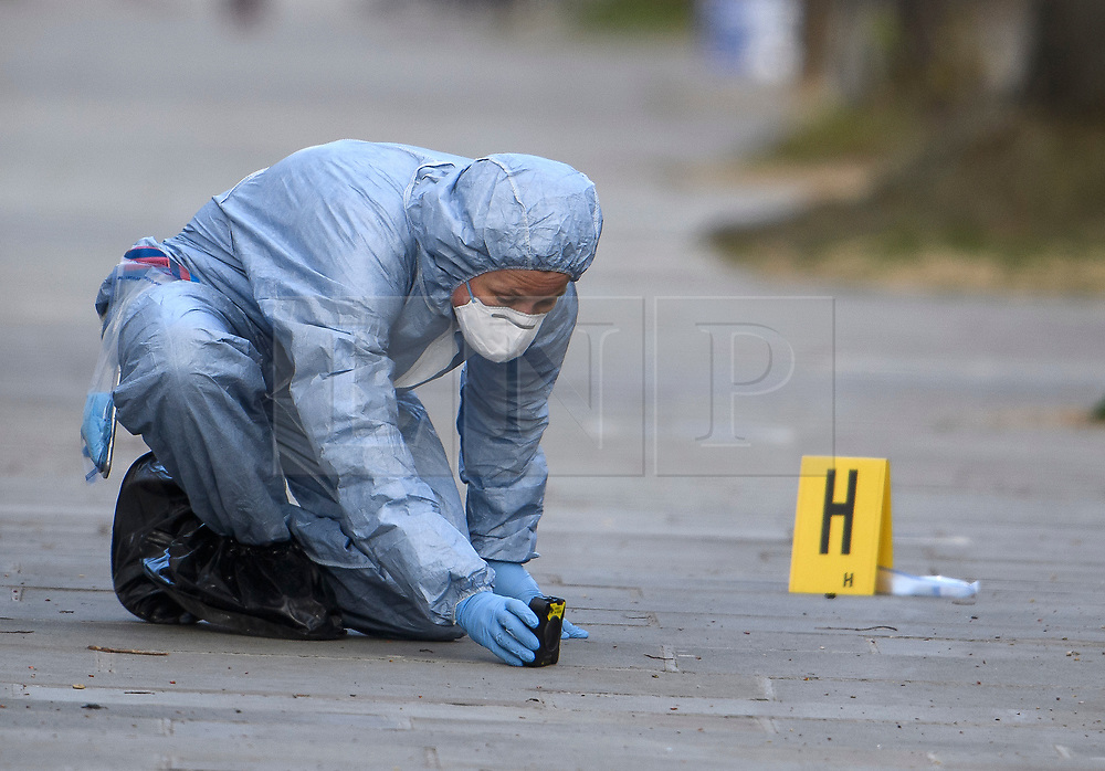 © Licensed to London News Pictures. 13/04/2019. London, UK. A police forensics officer videos evidence at the scene in Holland Park after shots were fired near the Ukrainian embassy. Photo credit: Ben Cawthra/LNP