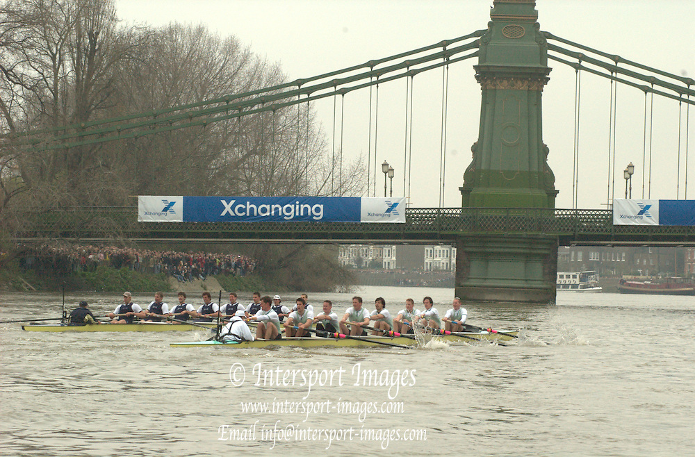 2005 Varsity Boat Race, Greater London, ENGLAND, Boat Race between Oxford [Dark Blue] and Cambridge[ Light Blue] over the Championship Course between Putney and Mortlake...CUBC Crew [Light Blue] - Bow. Luke Walton, 2. Tom Edwards, 3. Henry Adams, 4 Steffen Buschbacher, 5. Sebastian Schlute, 6. Matthias Kleinz, 7. Tom James, Stroke, Bernd Heidicker, and cox. Peter Rudge...OUBC Crew [Dark Blue] - Bow. Robin Bourne-Taylor, 2. Barney Williams, 3. Peter Reed, 4. Joe Von Maltzahn, 5. Chris Liwski, 6. Mike Blomquist, 7. Jason Flickinger, Stroke, Andy Twiggs-Hodge, cox Acer Nethercott. ..Photo  Peter Spurrier. .email images@intersport-images....[Mandatory Credit Peter Spurrier/ Intersport Images] Varsity:Boat Race