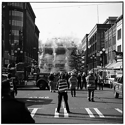 Seattle Police and Fire Department personnel watch the implosion of the Kingdome from 2nd Avenue South, March 26, 2000.