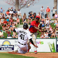 March 9, 2011; Lakeland, FL, USA; Philadelphia Phillies shortstop Jimmy Rollins (11) forces out Detroit Tigers catcher Victor Martinez (41) and completes a double play during a spring training exhibition game at Joker Marchant Stadium.  Mandatory Credit: Derick E. Hingle-US PRESSWIRE