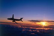 Airliner banking away as night falls