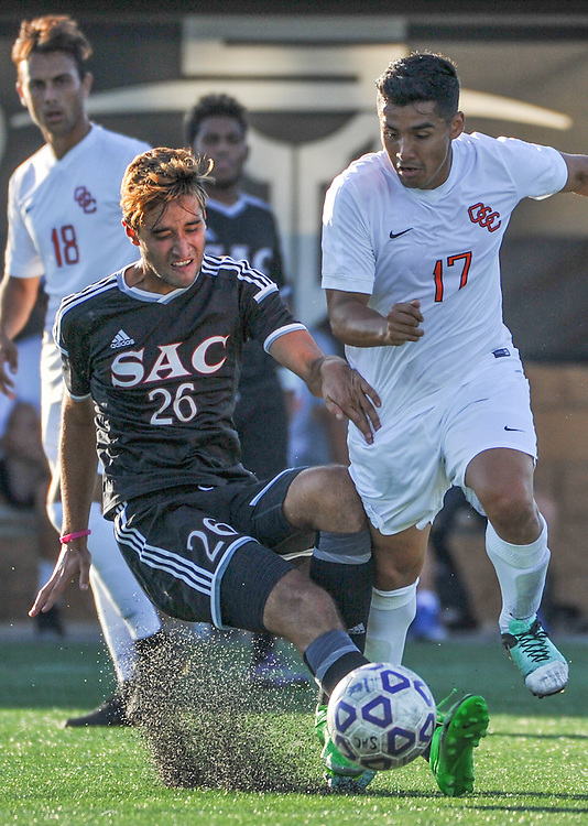 11/4/16 4:42:29 PM Orange Coast College Pirate midfielder Eddie Villegas (17) battles with a Santa Ana College Don player during the second half of the men's soccer match between Orange Coast College and Santa Ana College, on the campus of Santa Ana College, Santa Ana, CA<br /> <br /> Photo by Joshua D. McKee