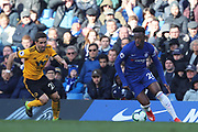 Chelsea Midfielder Callum Hudson-Odoi takes on Wolverhampton Wanderers midfielder Joao Moutinho (28) during the Premier League match between Chelsea and Wolverhampton Wanderers at Stamford Bridge, London, England on 10 March 2019.