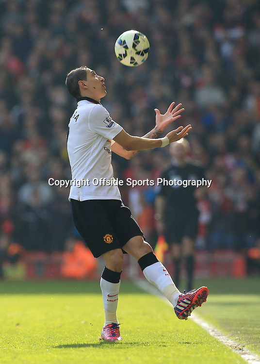 22nd March 2015 - Barclays Premier League - Liverpool v Manchester United - Angel Di Maria of Man Utd catches the ball before it has left the pitch - Photo: Simon Stacpoole / Offside.