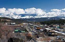 Aerial view of historic downtown Truckee, California, United States of America with snow capped mountains and railroad.