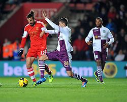 Aston Villa's Matthew Lowton tackles Southampton's Pablo Daniel Osvaldo - Photo mandatory by-line: Alex James/JMP - Tel: Mobile: 07966 386802 04/12/2013 - SPORT - Football - Southampton - St Mary's Stadium - Southampton v Aston Villa - Barclays Premier League