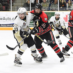 TRENTON, ON - Apr 22, 2016 -  Ontario Junior Hockey League game action between the against the Trenton Golden Hawks and the Georgetown Raiders. Game 5 of the Buckland Cup Championship Series, at the Duncan Memorial Gardens in Trenton, Ontario. Josh Allan #53 of the Trenton Golden Hawks battles for control with Matthew Cairns #55 of the Georgetown Raiders during the second period.<br /> (Photo by Andy Corneau / OJHL Images)