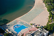 A hotel with a water pool on the beach