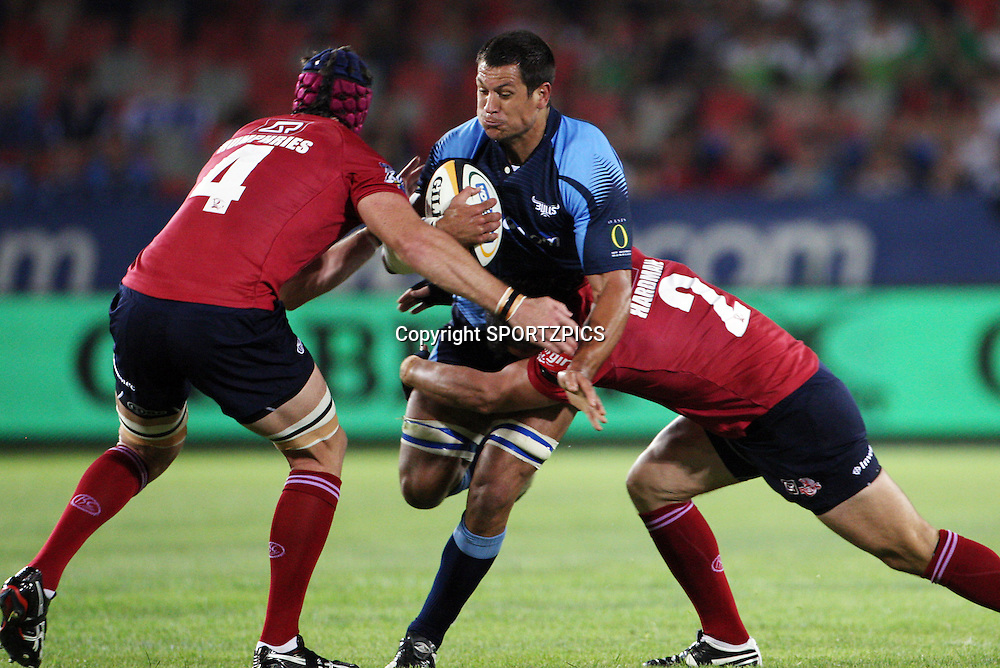PRETORIA, South Africa, Pierre Spies stopped by Sean Hardman and Van Humphries during the Super 14 match between the Bulls and the Reds held at Loftus Versfeld in Pretoria on the 14 February 2009..Photo By Barry Aldworth/ SPORTZPICS