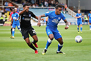 Peterborough United forward Ivan Toney (17) shields the ball from Portsmouth defender Nathan Thompson (20) during the EFL Sky Bet League 1 match between Peterborough United and Portsmouth at London Road, Peterborough, England on 15 September 2018.