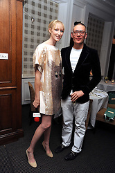 JADE PARFITT and GILES DEACON at Vogue's Celebation of Fashion dinner held at The Albermarle, Brown's Hotel, Albermarle Street, London on 18th September 2008.