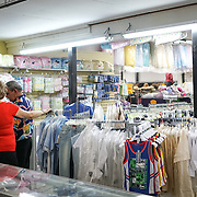 HIALEAH, FLORIDA - JUNE 24, 2016<br /> A customer receives assistance as he shops for baby clothing for sale in Noooo (&ntilde;oooo) Que Barato,  in Hialeah, Florida. The store sells all kinds of goods and is a very popular stop for Cubans who are traveling to Cuba to stock up on supplies to carry to relatives in the island nation.<br /> (Photo by Angel Valentin/Freelance)