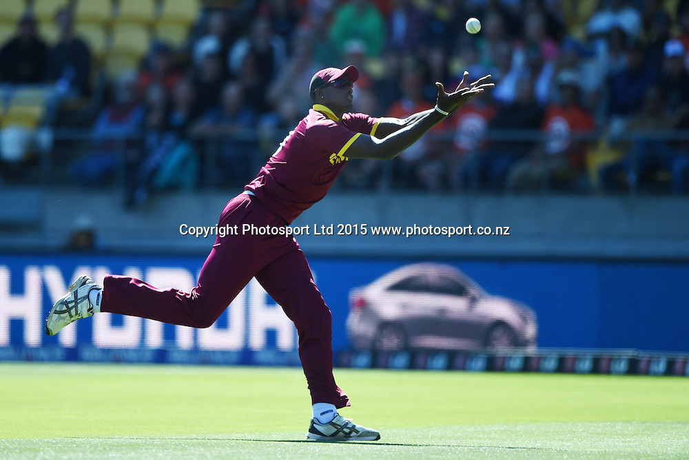 Jason Holder takes a catch to dismiss McCullum during the ICC Cricket World Cup quarter final match between New Zealand Black Caps and the West Indies, Wellington, New Zealand. Saturday 21March 2015. Copyright Photo: Andrew Cornaga / www.Photosport.co.nz
