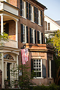 US flag outside a historic Charleston Single style home in Charleston, SC.