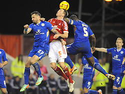 Forests DANNY COLLINS, is sandwiched by Leicesters Defence, Nottingham Forest v Leicester City, City Ground Nottingham,  Sky Bet Championship, 19th Febuary 2014