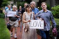 Barbara Simmons (center) of the Bucks County Peace Center walks with her husband Steve Nolan (right) during an Interfaith Prayer Walk for peace, racial justice and reconciliation Tuesday June 23, 2015 in Langhorne, Pennsylvania. (Photo by William Thomas Cain)