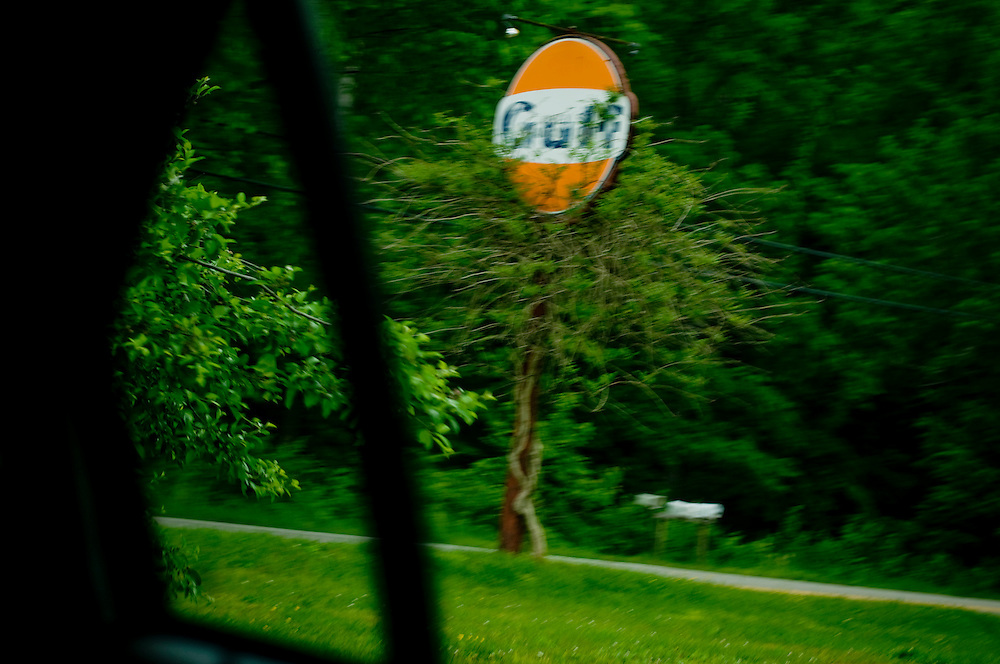 An old Gulf gas station sign by the road outside Whitesville, West Virginia..Photographer: Chris Maluszynski /MOMENT