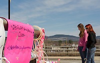 Visitors stopped by throughout the day on Monday to observe and share a few moments at the memorial for Lily Johnson with well wishes for Alyssa Miner at the Messer Street bridge in Laconia following the tragic accident on Friday afternoon.   (Karen Bobotas/for the Laconia Daily Sun)