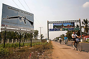 Many signs on the national road that connects Phnom Penh and Battambang to Sieam Reap and the border with Thailand, campaign against the use of guns